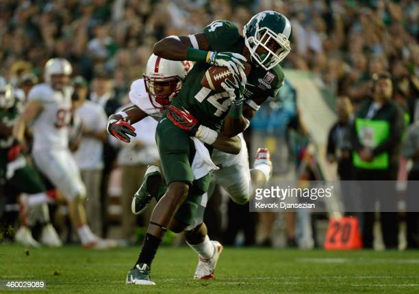 Wide receiver Tony Lippett of the Michigan State Spartans makes a catch for a touchdown in the fourth quarter of the 100th Rose Bowl Game presented...