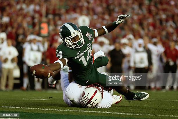 Wide receiver Tony Lippett of the Michigan State Spartans reaches the ball out for a touchdown in the fourth quarter of the 100th Rose Bowl Game...