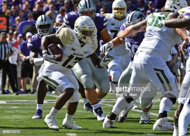 Wide receiver Tony Nicholson of the Baylor Bears rushes with the ball against the Kansas State Wildcats during the first half on September 30 2017 at...