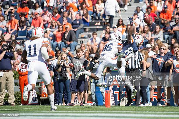 Wide receiver Tony Stevens of the Auburn Tigers attempts to catch a pass in front of defensive back Michael Sherwood of the Auburn Tigers at Jordan...
