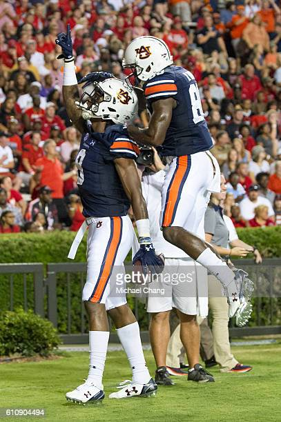 Wide receiver Tony Stevens of the Auburn Tigers celebrates with wide receiver Griffin King of the Auburn Tigers after scoring a touchdown during...