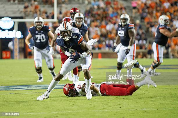Wide receiver Tony Stevens of the Auburn Tigers dodges a tackle by defensive back Cody Brown of the Arkansas State Red Wolves at Jordan Hare Stadium...
