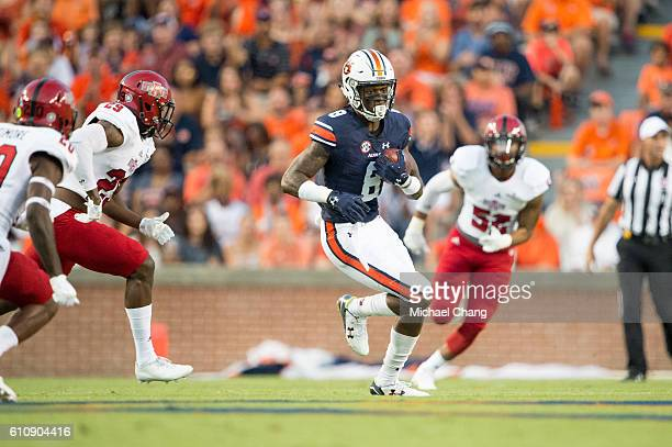 Wide receiver Tony Stevens of the Auburn Tigers looks to run the ball my defensive back Chris Humes of the Arkansas State Red Wolves at Jordan Hare...