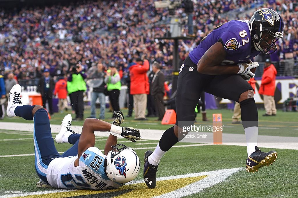 Wide receiver Torrey Smith #82 of the Baltimore Ravens catches a 4th quarter touchdown past cornerback Blidi Wreh-Wilson #25 of the Tennessee Titans at M&T Bank Stadium on November 9, 2014 in Baltimore, Maryland.