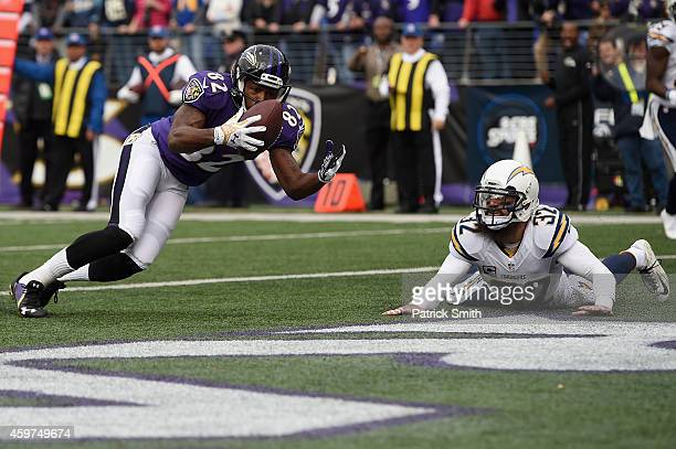 Wide receiver Torrey Smith of the Baltimore Ravens catches a touchdown over free safety Eric Weddle of the San Diego Chargers in the first quarter of...