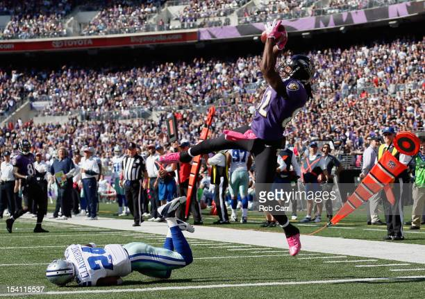 Wide receiver Torrey Smith of the Baltimore Ravens catches a touchdown pass in front of cornerback Morris Claiborne of the Dallas Cowboys during the...
