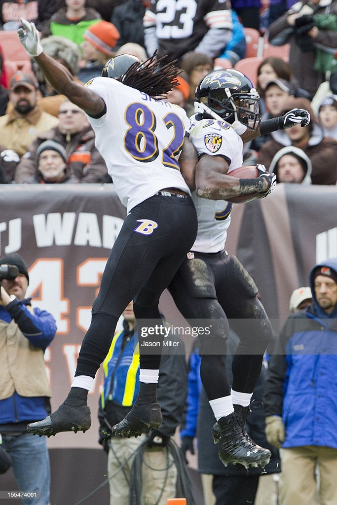 Wide receiver Torrey Smith #82 of the Baltimore Ravens celebrates with teammate running back Bernard Pierce #30 after Pierce scored a touchdown during the first half against the Cleveland Browns at Cleveland Browns Stadium on November 4, 2012 in Cleveland, Ohio.