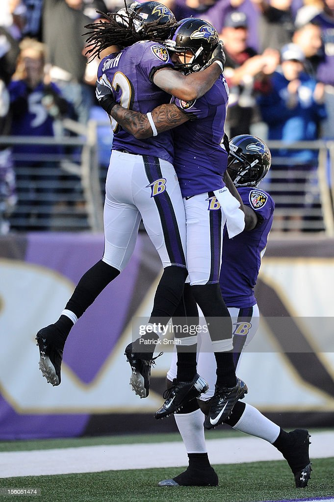 Wide receiver Torrey Smith #82 of the Baltimore Ravens celebrates with teammates after scoring a touchdown in the third quarter against the Oakland Raiders at M&T Bank Stadium on November 11, 2012 in Baltimore, Maryland. The Baltimore Ravens won, 55-20.