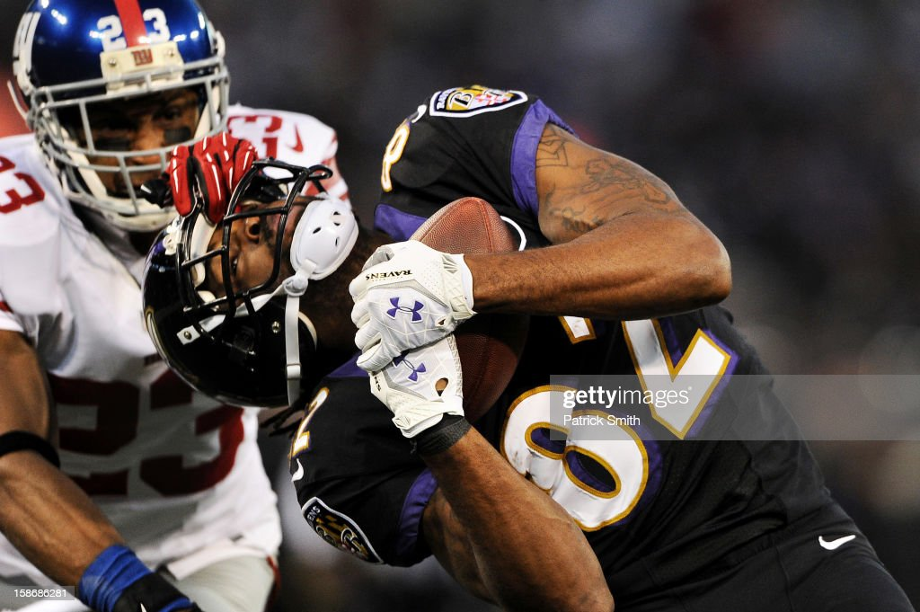 Wide receiver Torrey Smith #82 of the Baltimore Ravens makes a catch past cornerback Corey Webster #23 of the New York Giants in the first quarter at M&T Bank Stadium on December 23, 2012 in Baltimore, Maryland.
