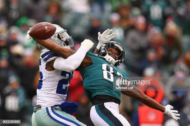 Wide receiver Torrey Smith of the Philadelphia Eagles attempts a catch against strong safety Xavier Woods of the Dallas Cowboys during the first...