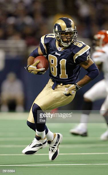 Wide receiver Torry Holt of the St Louis Rams carries the ball during the game against the Cincinnati Bengals on December 21 2003 at the Edward Jones...