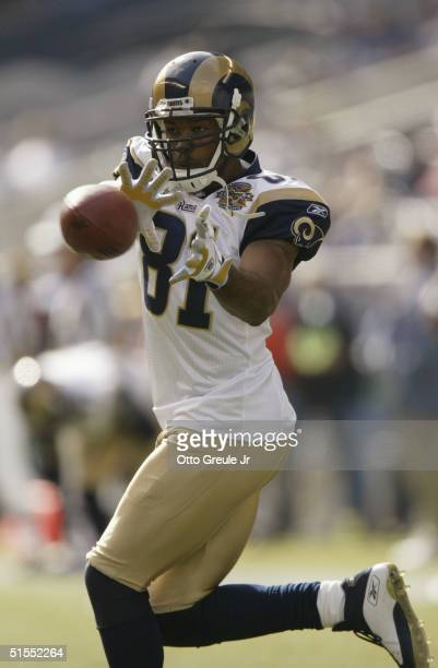 Wide receiver Torry Holt of the St Louis Rams catches the ball during the game with the Seattle Seahawks at Qwest Field on October 10 2004 in Seattle...