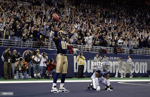 Wide receiver Torry Holt of the St Louis Rams celebrates in the endzone after scoring a touchdown during the game against the Seattle Seahawks on...