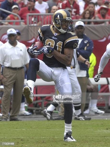 Wide receiver Torry Holt of the St Louis Rams grabs a midfield pass against the Tampa Bay Buccaneers at Raymond James Stadium on September 23 2007 in...