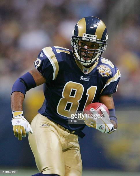 Wide receiver Torry Holt of the St Louis Rams runs upfield against the New England Patriots on November 7 2004 at the Edward Jones Dome in St Louis...