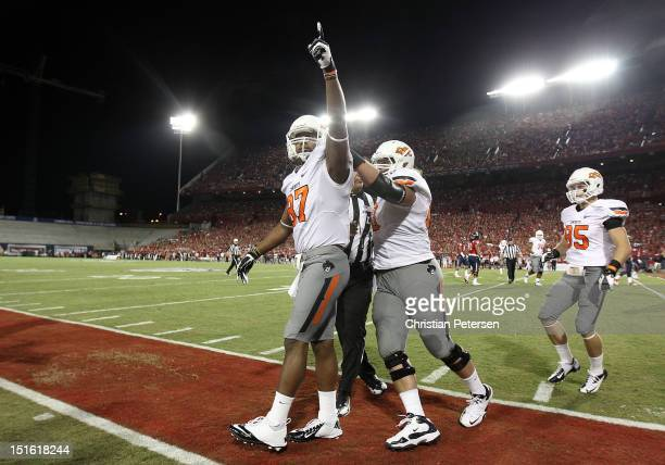 Wide receiver Tracy Moore of the Oklahoma State Cowboys celebrates after scoring on a 9 yard touchdown reception against the Arizona Wildcats during...