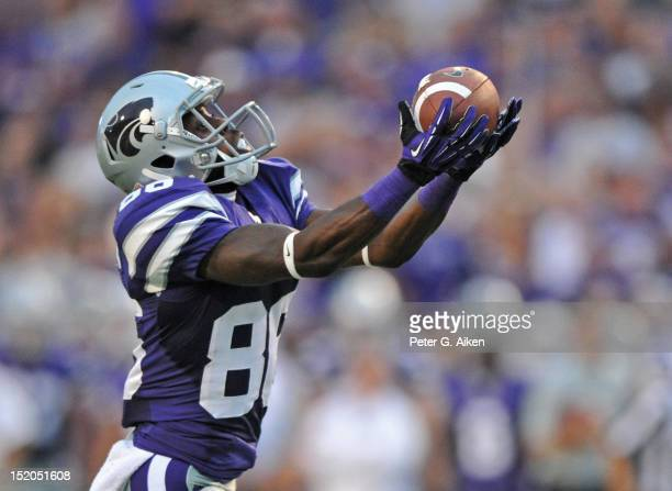 Wide receiver Tramaine Thompson of the Kansas State Wildcats catches a 38yard touchdown pass against the North Texas Mean Green during the second...