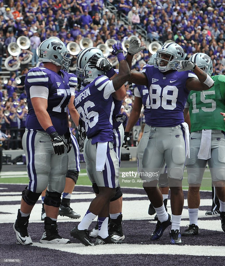 Wide receiver Tramaine Thompson #86 of the Kansas State Wildcats celebrates with teammate Torell Miller #88 after scoring a touchdown during the Purple and White Spring Game on April 27, 2013 at Bill Snyder Family Stadium in Manhattan, Kansas.