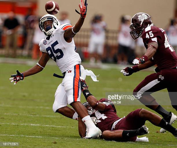 Wide receiver Travante Stallworth of the Auburn Tigers fumbles the ball after being tackled by defensive back Cedric Jiles of the Mississippi State...
