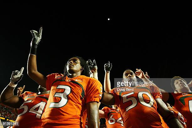 Wide receiver Travis Benjamin and linebacker Darryl Sharpton of the Miami Hurricanes celebrate after defeating the Oklahoma Sooners at Land Shark...