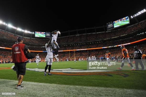 Wide receiver Travis Benjamin of the Los Angeles Chargers celebrates scoring a touchdown with Keenan Allen in the fourth quarter of the game against...