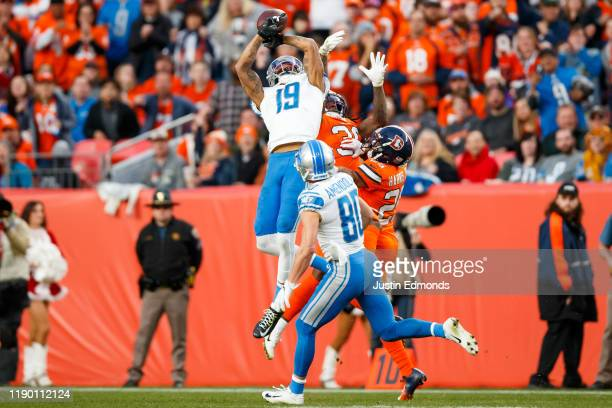 Wide receiver Travis Fulgham of the Detroit Lions is unable to catch a deep pass as safety Trey Marshall of the Denver Broncos defends on the play...