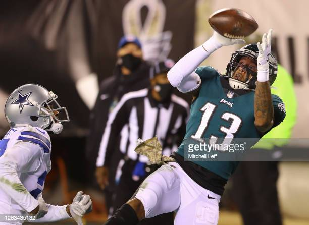 Wide receiver Travis Fulgham of the Philadelphia Eagles makes a touchdown reception against Trevon Diggs of the Dallas Cowboys in the third quarter...