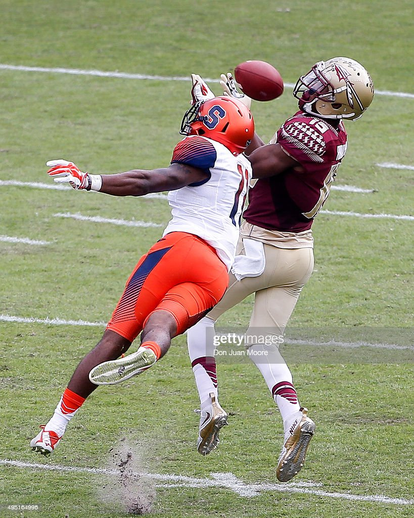 Wide Receiver Travis Rudolph #15 of the Florida State Seminoles makes a catch over Cornerback Corey Winfield #11 of the Syracuse Orange during the game at Doak Campbell Stadium on Bobby Bowden Field on October 31, 2015 in Tallahassee, Florida. Florida State defeated Syracuse 45 to 21.