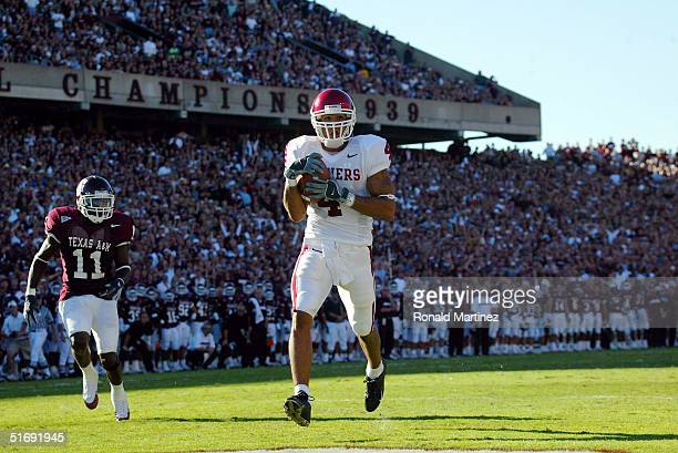 Wide receiver Travis Wilson of the University of Oklahoma Sooners makes a touchdown pass reception in front of Byron Jones of the Texas AM University...