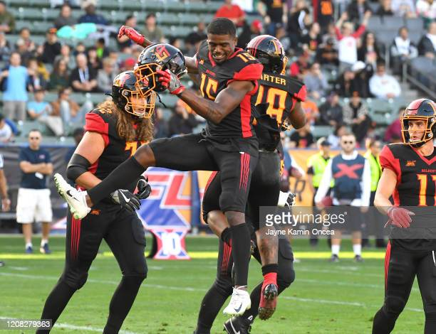 Wide receiver Tre McBride celebrates with running back Martez Carter of the LA Wildcats after a touchdown in the first half of the XFL game against...