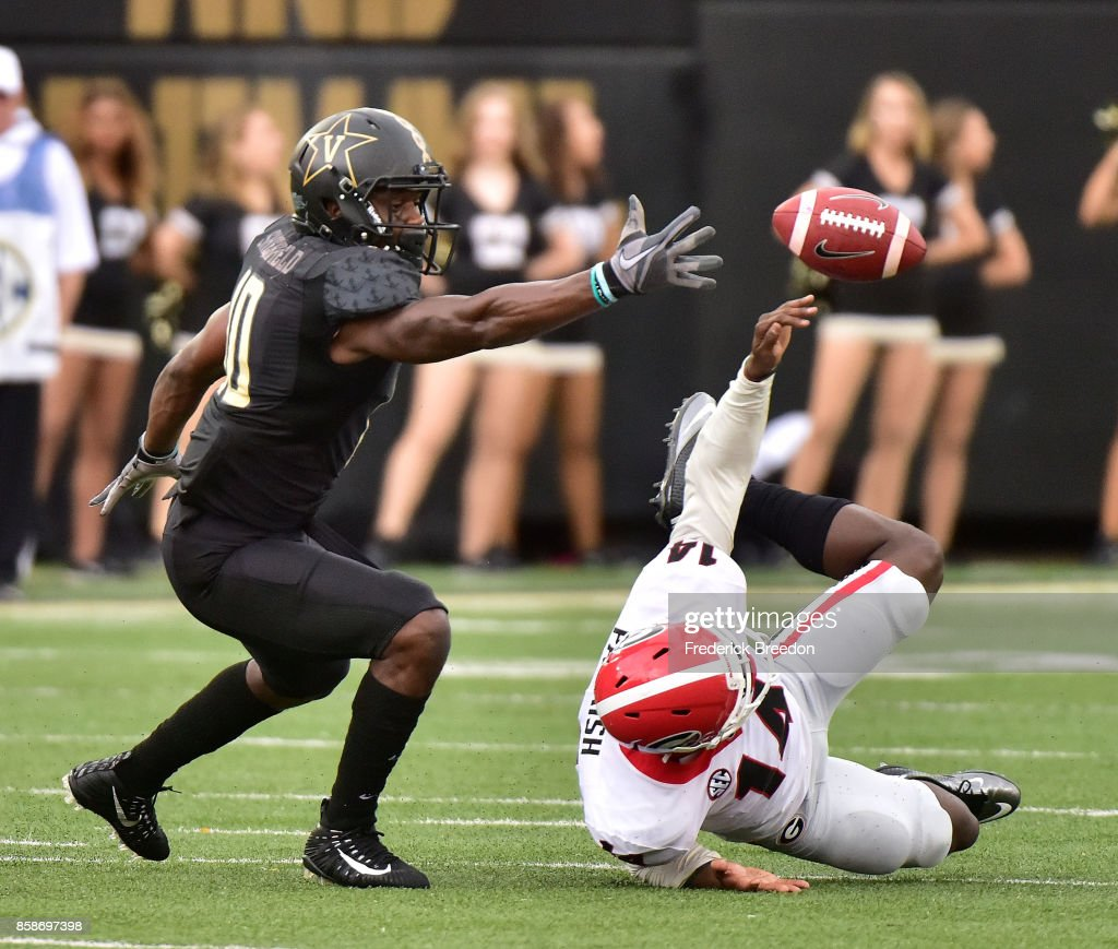 Wide receiver Trent Sherfield #10 and Malkom Parrish #14 of the Georgia Bulldogs fight for a bouncing pass during the first half at Vanderbilt Stadium on October 7, 2017 in Nashville, Tennessee.
