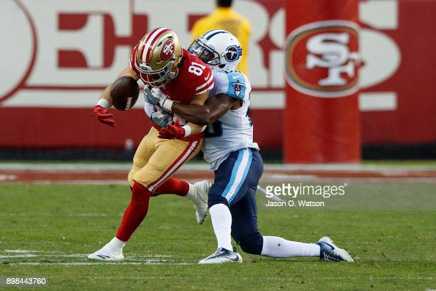 Wide receiver Trent Taylor of the San Francisco 49ers is tackled by cornerback Brice McCain of the Tennessee Titans during the fourth quarter at...