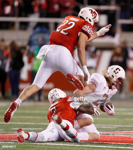 Wide receiver Trenton Irwin of the Stanford Cardinal catches a pass as defensive back Chase Hansen and defensive back Jaylon Johnson of the Utah Utes...