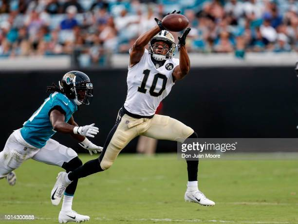 Wide Receiver Tre'Quan Smith of the New Orleans Saints makes a catch over Cornerback Tre Harndon of the Jacksonville Jaguars during a preseason game...