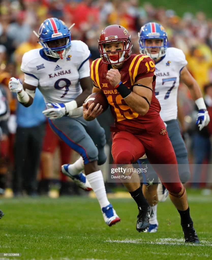 Wide receiver Trever Ryen #19 of the Iowa State Cyclones drives the ball past linebacker Kyron Johnson #9, and linebacker Keith Loneker Jr. #47 of the Kansas Jayhawks as he rushed for yards in the first half of play at Jack Trice Stadium on October 14, 2017 in Ames, Iowa.