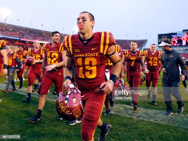Wide receiver Trever Ryen of the Iowa State Cyclones leaves the field with his teammates after the won 450 over the Kansas Jayhawks in the second...