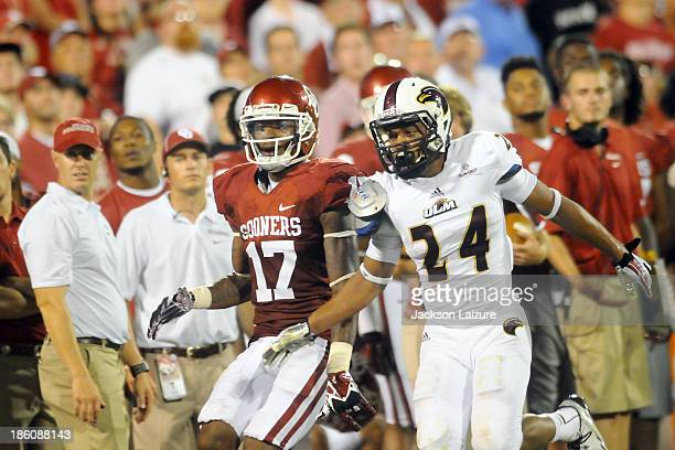 Wide receiver Trey Metoyer of the Oklahoma Sooners is defended by Trey Caldwell of the Louisiana-Monroe Warhawks on August 31, 2013 at the Gaylord...
