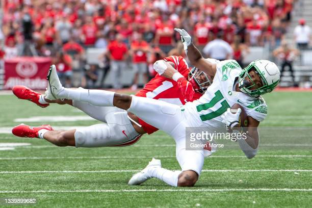 Wide receiver Troy Franklin of the Oregon Ducks is tackled by safety Ronnie Hickman of the Ohio State Buckeyes during the second quarter at Ohio...