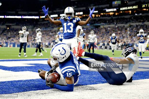 Wide receiver TY Hilton of the Indianapolis Colts celebrates after wide receiver Dontrelle Inman scores a touchdown in the fourth quarter of the game...