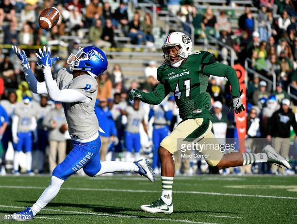 Wide receiver Ty Lee of the Middle Tennessee Blue Raiders makes a touchdown reception over defensive back AJ McDonald of the Charlotte 49ers during...