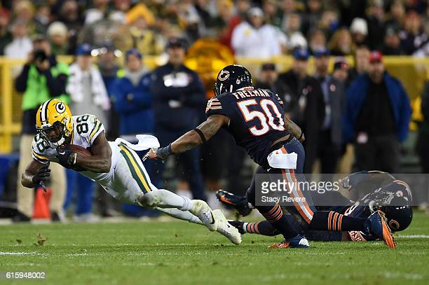 Wide receiver Ty Montgomery of the Green Bay Packers carries the ball against inside linebacker Jerrell Freeman of the Chicago Bears in the third...