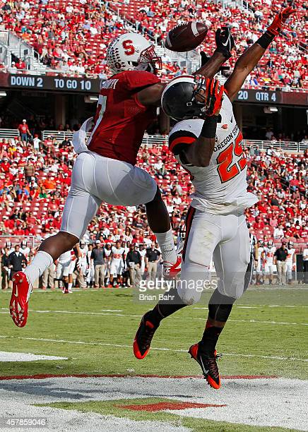 Wide receiver Ty Montgomery of the Stanford Cardinal can't pull down a pass in the endzone against safety Ryan Murphy of the Oregon State Beavers in...