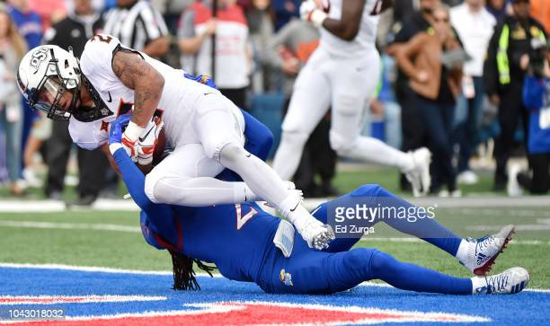 Wide Receiver Tylan Wallace of the Oklahoma State Cowboys goes in for 11 yard touchdown reception against cornerback Corione Harris of the Kansas...
