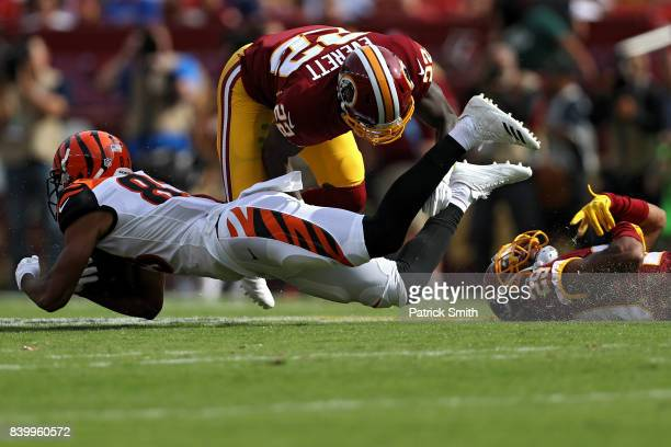 Wide receiver Tyler Boyd of the Cincinnati Bengals is tackled by cornerback Deshazor Everett of the Washington Redskins in the first half during a...
