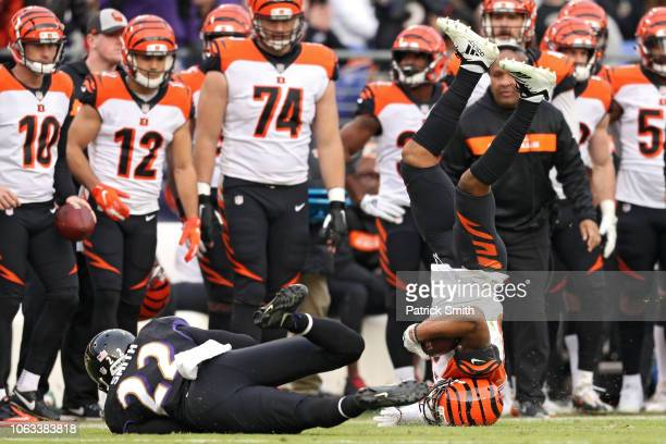 Wide receiver Tyler Boyd of the Cincinnati Bengals jumps over cornerback Jimmy Smith of the Baltimore Ravens during the fourth quarter at MT Bank...