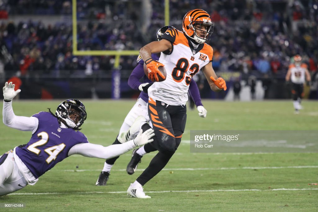 Wide receiver Tyler Boyd #83 of the Cincinnati Bengals runs for a touchdown in the fourth quarter against the Baltimore Ravens at M&T Bank Stadium on December 31, 2017 in Baltimore, Maryland.