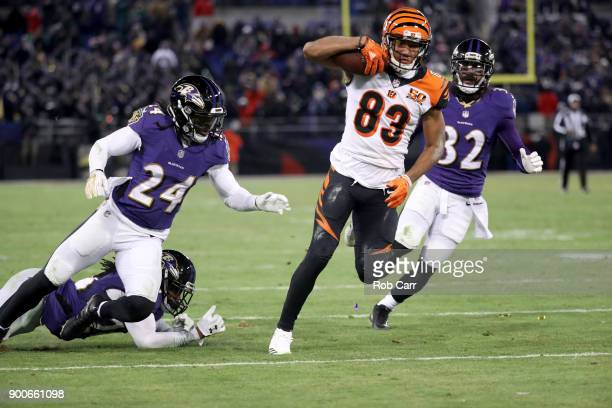 Wide receiver Tyler Boyd of the Cincinnati Bengals rushes with the ball after making a catch in front of cornerback Brandon Carr and free safety Eric...