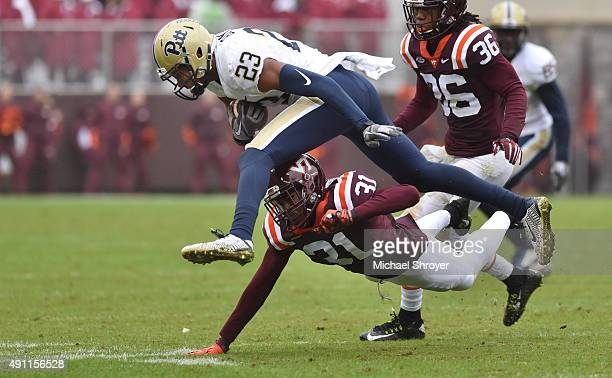 Wide receiver Tyler Boyd of the Pittsburgh Panthers is tackled after a reception by cornerback Brandon Facyson of the Virginia Tech Hokies in the...
