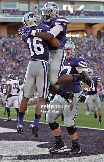 Wide receiver Tyler Lockett of the Kansas State Wildcats celebrates with his teammates after catching a 9 yard touchdown pass against the Stephen F...