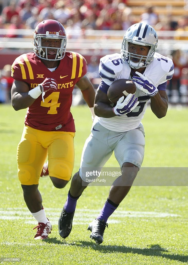 Wide receiver Tyler Lockett #16 of the Kansas State Wildcats drives the ball past defensive back Sam E. Richardson #4 of the Iowa State Cyclones in the first half of play at Jack Trice Stadium on September 6, 2014 in Ames, Iowa.